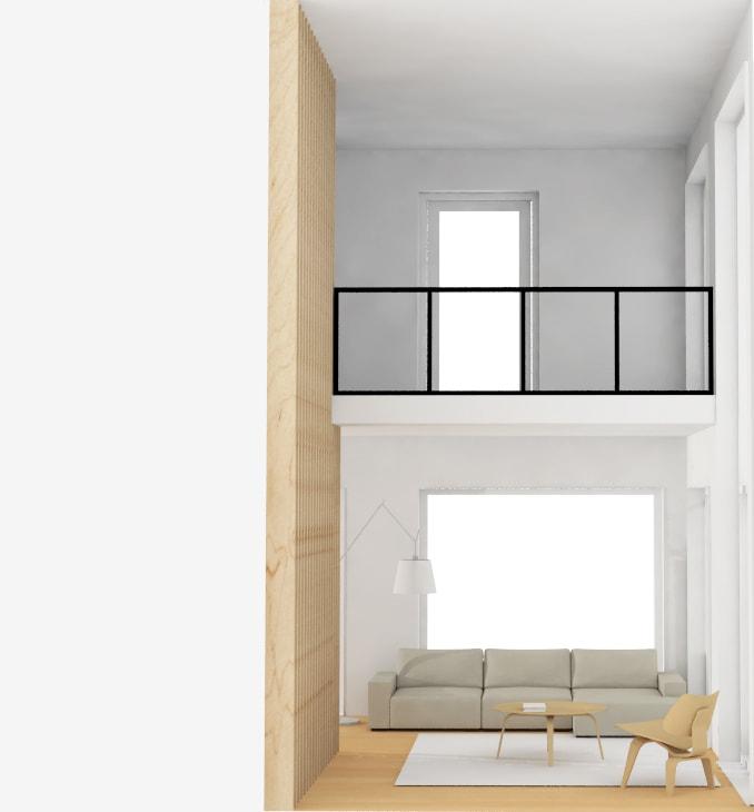 Vide woonkamer met balustrade van zwart staal en glas