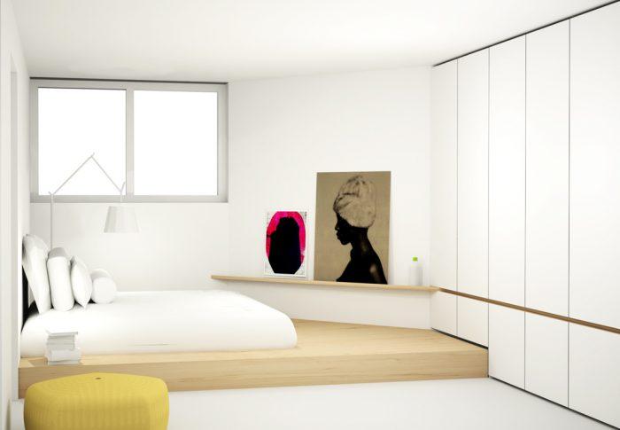 Tweepersoons bed op verhoging in slaapkamer met design kastenwand